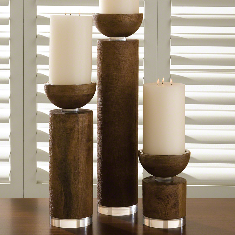 Traditional pillar candles are classic staples available in scented, unscented & in a variety of heights & sizes. They really set the mood as dinner party centerpieces. Try a modern twist by mixing & matching multiple heights & colors on a mantel or table display.